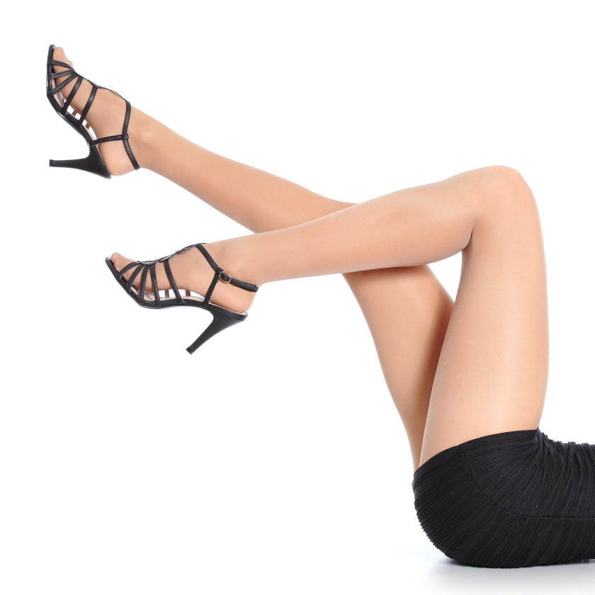 Woman Legs With Stockings And Heels Pointing Up